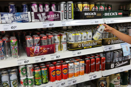 GERMANY - AUGUST 2015: Aisle with a variety of energy drinks in cans and Radlers in a Real Hypermarket. Real is a European hypermarket, member of the German retail giant Metro AG.