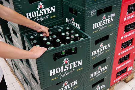 pilsener: GERMANY - AUGUST 2015: Stack of Holsten Pilsener beer crates in a Kaufland hypermarket. Holsten Brewery is owned by the Danish brewing company Carlsberg Group