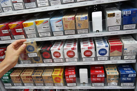 PAPENBURG, GERMANY - AUGUST 2015: Cigarette packages with the warning: smoking is lethal in a Kaufland hypermarket cigarette counter.
