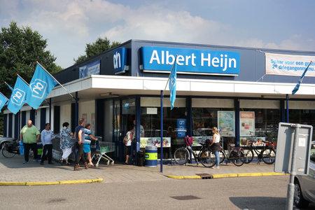 retailer: THE NETHERLANDS - AUGUST 2015: Albert Heijn Supermarket. Albert Heijn is the biggest Dutch supermarket chain in The Netherlands owned by Koninklijke Ahold NV, a Dutch international retailer.