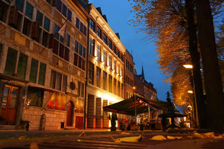 buidings: MAASEIK, BELGIUM - OCTOBER 2015: Illuminated historic buidings on Market Square in Maaseik, a town in the Belgian province of Limburg. Editorial