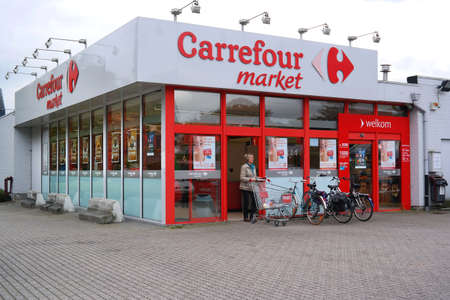 carrefour: KAPELLEN, BELGIUM - OCTOBER 2015: Branch of a Carrefour supermarket. Carrefour is a French multinational retailer.