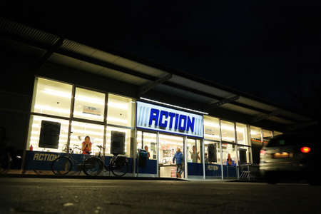 operates: NORDHORN, GERMANY - DECEMBER 2014: Branch of Action, a Dutch discount store chain. Sells in Their variety stores low budget products. Action Operates over 400 stores in the Netherlands, Belgium, Germany and France.
