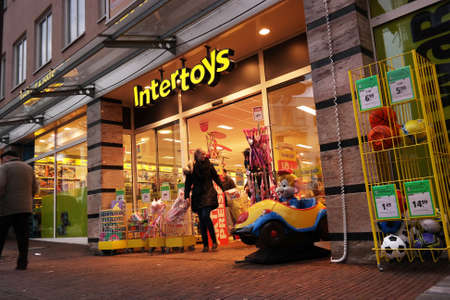 toyshop: NORDHORN, GERMANY - DECEMBER 2014: Branch of a Dutch Intertoys Toy store chain with branches The Netherlands, Belgium, Germany
