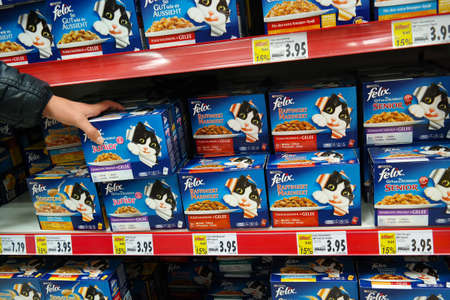 nestle: GERMANY - DECEMBER 2015: Shelves with Felix pet food packings in a Kaufland supermarket. Felix is a fire or cat food, owned by Nestle Purina PetCare Company, a Subsidiary of Nestle. Editorial
