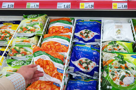 packet: GERMANY - DECEMBER 2015: Various Frozen Vegetables packings in a Kaufland supermarket.