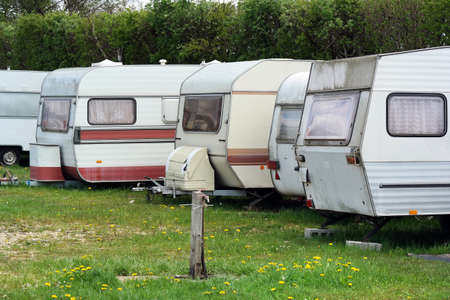 camping site: Row of old-fashioned caravans on a camping site in Belgium. Stock Photo