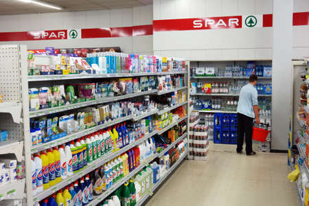 STAVELOT, BELGIUM - JULY 27, 2015: Interior of a SPAR supermarket. Spar is a Dutch multinational retail chain Operates as independent or franchised in 35 countries worldwide. Editoriali