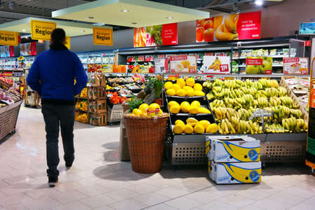 MEPPEN, GERMANY - MARCH 2016: Fruits and vegetables on the fresh department of a REWE supermarket. The REWE Group is the second largest supermarket chain in Germany. Publikacyjne