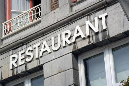 old building facade: The word Restaurant at facade of old building in Wallonia, Belgium.
