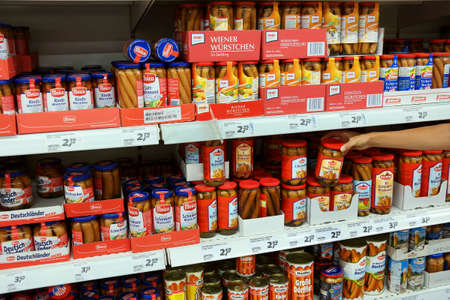 canned meat: GERMANY - AUGUST 2015: Aisle with a variety of canned Frankfurter sausages products in a Real hypermarket. Editorial