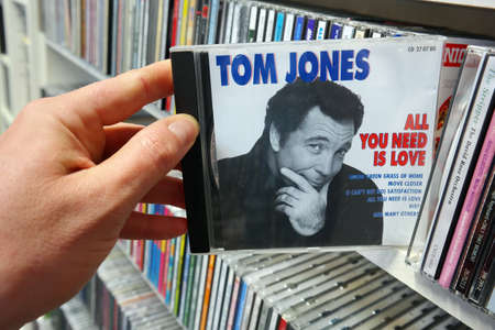 compilation: THE NETHERLANDS - APRIL 2016: Compilation CD record, All You Need Is Love, or the Welsh pop singer Tom Jones in a second hand store. Editorial