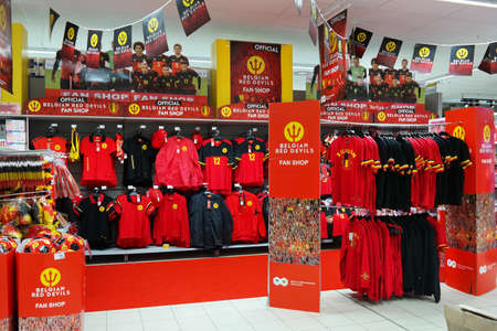 carrefour: MALMEDY, BELGIUM - MAY 2016: Fan shop department of The Red Devils The Belgian national football team for Euro 2016, in a Carrefour Hypermarket Editorial