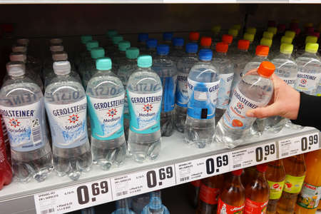 Mineral: GERMANY - MARCH 2016: Selecting Gerolsteiner Mineral Water in a REWE Supermarket. Gerolsteiner Brunnen is a leading German mineral water firm with its seat in Gerolstein in the Eifel mountains. Editorial