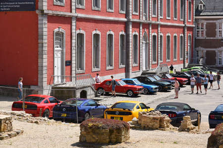 lizzie: STAVELOT, BELGIUM - MAY 2016: Ford Mustang owners club take a pause, and Their vehicles park at the Abbeys courtyard during Their tour of belgium.