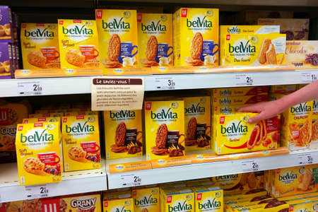 carrefour: BELGIUM - MAY 2016: Shelves with Belvita in a Carrefour Supermarket. Belvita is a fire or breakfast biscuit sold by mondel?z international. Editorial