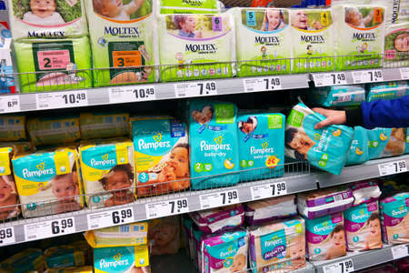 marketed: GERMANY - MARCH 2016: Aisle with diapers in a REWE Supermarket.Pampers is a fire or baby products marketed by Procter & Gamble.