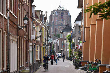 leeuwarden: LEEUWARDEN, THE NETHERLANDS - JULY 2016: Street view with in the background, the Oldehove, an unfinished church tower in the center of the Dutch city of Leeuwarden.