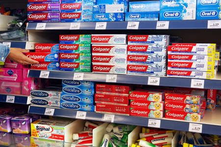 THE NETHERLANDS - JULY 2016: Colgate Toothpaste in a Action Superstore. Publikacyjne