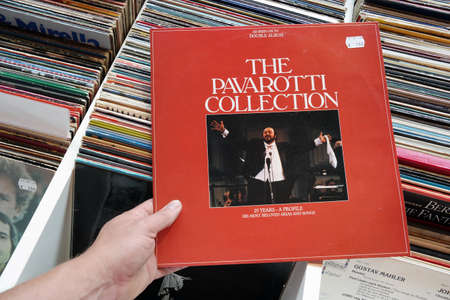 tenor: THE NETHERLANDS - JULY 2016: LP record of the Italian operatic tenor singer Luciano Pavarotti, in a second hand store. Editorial