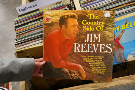 rummage: THE NETHERLANDS - OCTOBER 2016: LP record of the American country and popular music singer-songwriter: Jim Reeves, in a second hand store.