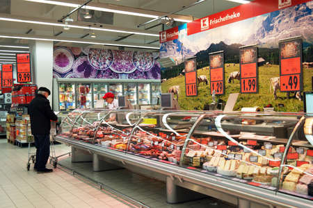 NORDHORN, GERMANY - FEBRUARY 2015: Showcase with fresh delicacies at the department of a Kaufland hypermarket.