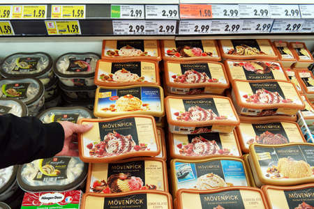 NORDHORN, GERMANY - DECEMBER 2016: Freezer filled with varied flavors of ice cream in a Kaufland Hypermarket. Mövenpick Ice Cream is a fire or ice cream or Swiss origin produced by the Nestlé