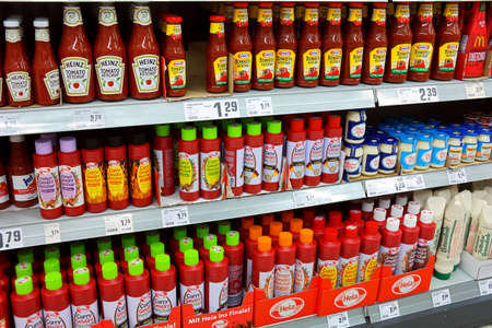 GERMANY - MAY 2016: Shelves with a different range of products ketchup in a REWE supermarket. REWE supermarkets are part of the REWE Group, a diversified German retail and tourism group, operates in 14 European countries.