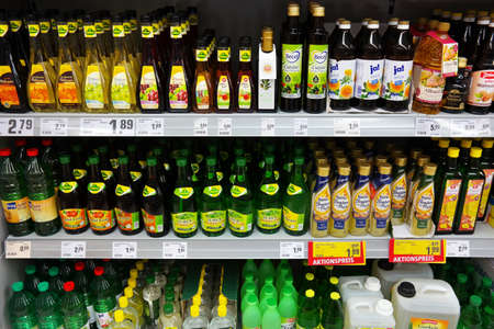 GERMANY - MAY 2016: Shelves or flavored Vinegars in a REWE supermarket. REWE supermarkets are part of the REWE Group, a diversified German retail and tourism group, operates in 14 European countries.