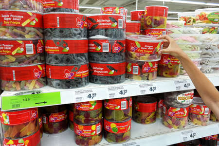 GERMANY - AUGUST 2015: Shelves with a variety of candies in boxes Real hypermarket. Publikacyjne