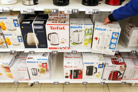 caldron: BELGIUM OCTOBER 2016: Different brands electric water heaters at an aisle with Domestic technology, home appliances at a Carrefour Hypermarket. Editorial