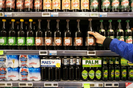 FLANDERS, BELGIUM - OCTOBER 2016: Aisle with various Small beers products in a Carrefour Hypermarket.