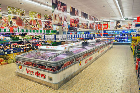 TURNHOUT, BELGIUM - OCTOBER 2016: Interior of a Lidl supermarket. the refrigerated aisle packed meat products