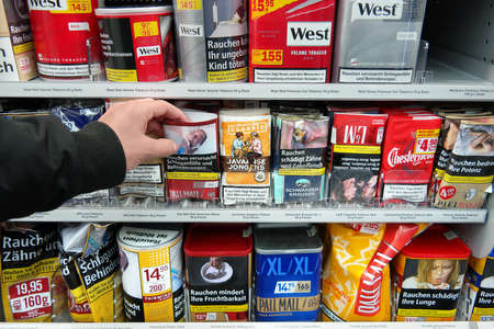 pall: GERMANY - DECEMBER 2016: Shelves with Tobacco packings for rollies in an Kaufland Hypermarket. A cigarette made with tobacco Tobacco May be called a rollie, a roll-up  dole-up or hand-rolled. Editorial