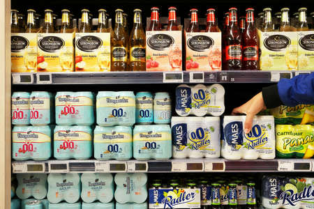 nonalcoholic beer: FLANDERS, BELGIUM - OCTOBER 2016: Aisle with various alcoholic and non-alcoholic beverages in a Carrefour Hypermarket