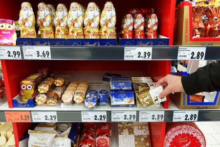 GERMANY - DECEMBER 2016: Shelves with Christmas chocolates in a German Kaufland hypermarket. Publikacyjne