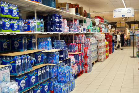 WALLONIA, BELGIUM - JULY 2015: Aisle with a variety of bottled water packings in a Carrefour Hypermarket.