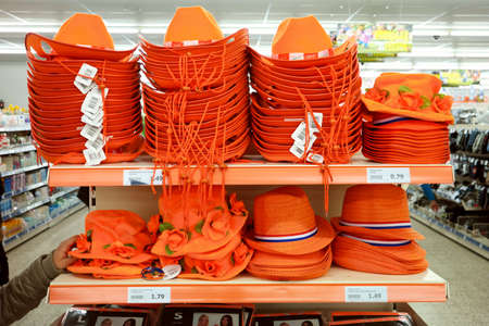 THE NETHERLANDS - MARCH 2017: Display with headgear for a orange outfit to celebrate Dutch kings day Publikacyjne