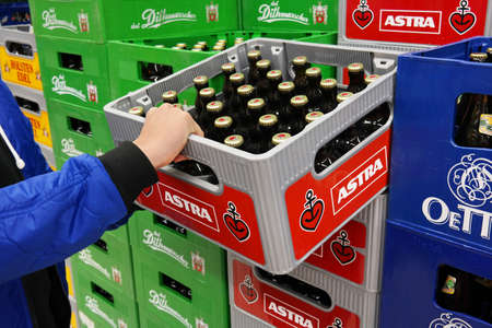 GERMANY - MARCH 2016: Stack of Astra pilsner beer crates in a Kaufland hypermarket. Astra beer brand is brewed by Holsten Brewery in Hamburg. Editorial