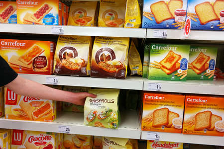 WALLONIA, BELGIUM - MAY 2016: Toast aisle. Shopping in the bakery section of a Carrefour supermarket. Rusk bread has a light, dry biscuit or piece or twice-baked bread.