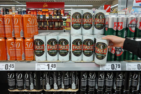 GERMANY - MAY 2017: 1000 ml. Faxe Premium stock cans in a REWE supermarket. Faxe Bryggeri A / S is a Danish Brewery located in the town of Faxe. Editorial