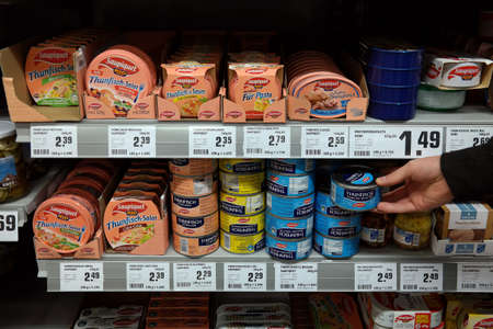 GERMANY - MAY 2017: Seafood conserve in a store. Saupiquet is a French brand in the canned fish market. Publikacyjne