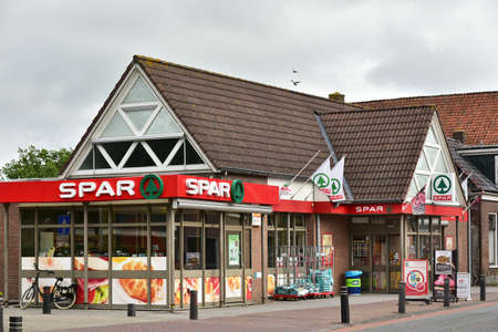 HALLUM, THE NETHERLANDS - JUNE 2017: SAVE the supermarket storefront. Spar is a Dutch multinational retail chain operates as independent or franchise in 35 countries worldwide.