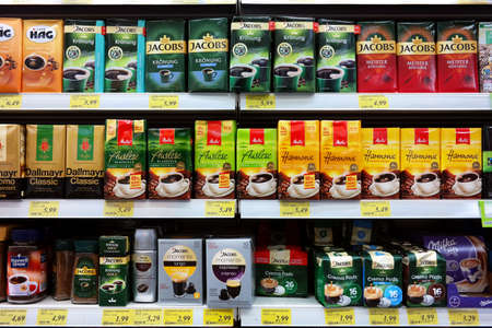 GERMANY - JULY 2017: Variety of coffee brands in the shelves of a Rewe supermarket.