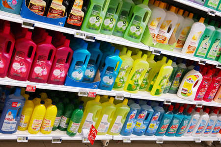 BELGIUM - OCTOBER 2014: Aisle with an assortment of cleaning products in a Carrefour hypermarket.