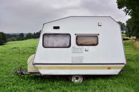 Old-fashioned 1980s Belgian fire mini caravan on a camping site in Belgium.