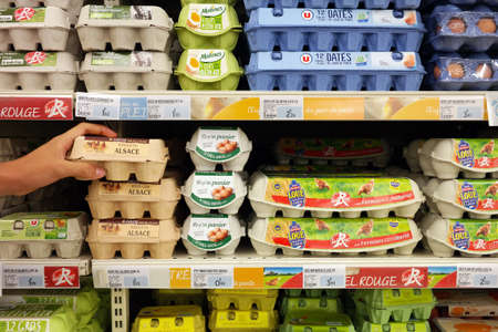 GRAND EST, FRANCE - AUGUST 2017: Eggs cartons in a Super U supermarket. Millions of eggs are being recalled from stores in Europe after some were found to contain high levels of a toxic insecticide. Publikacyjne
