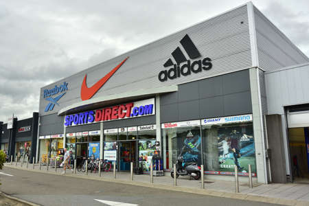 HERSTAL, BELGIUM - AUGUST 2017: Branch of SportsDirect.com in Belgium. Sports Direct is a British retailing group, UKs largest sports-retail retailer operates more than 670 stores worldwide. Publikacyjne