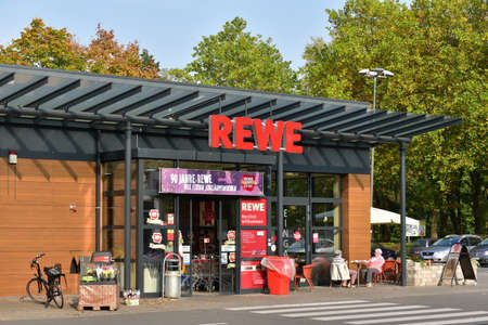 MEPPEN, GERMANY - OCTOBER 2017: Entrance and sidewalk of REWE supermarket, part of the REWE Group