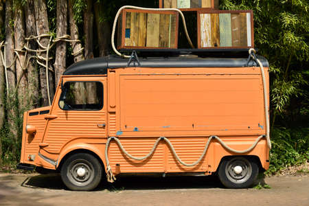 Old French Panel Van. Left side view of a vintage orange food truck.